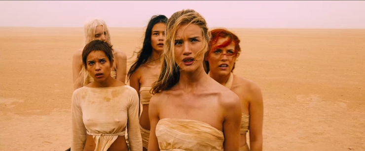 Screenshot of (back row) Abbey Lee, Courtney Eaton,  (front row) Zoe Kravitz, Rosie Huntington-Whiteley and Riley Keough as Joe's wives in